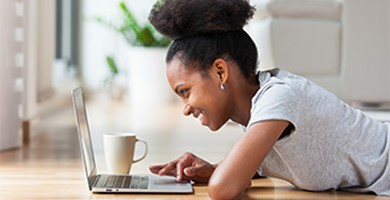 Online Security image showing young woman banking online
